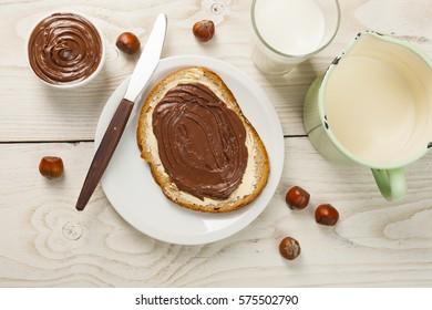 outdoor spring breakfast sweet bread spread on wooden table