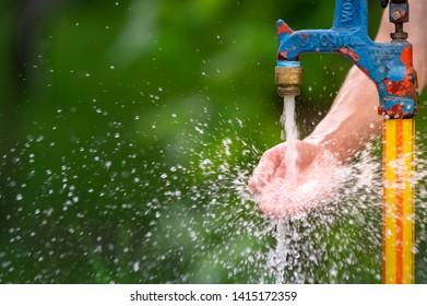 Outdoor Standing Spigot Water Splashing on Hand and Toward Viewer