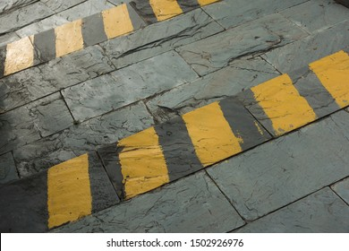 Outdoor stone ladder and yellow security line closeup