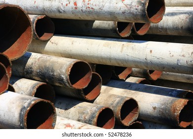 outdoor storage of rusty pipes