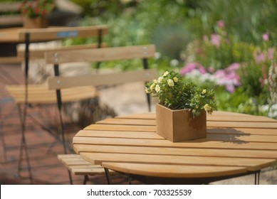 Outdoor street cafe tables with flowers