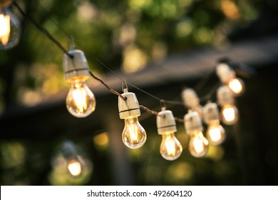 outdoor string lights hanging on a line in backyard