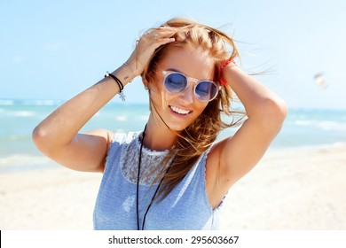 Outdoor summer colorful portrait of pretty young beautiful woman having fun on the beach