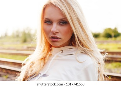 Outdoor summer portrait of the beautiful cute blonde girl close up