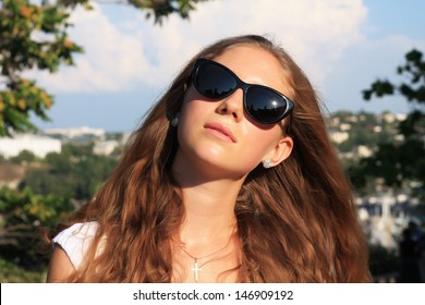 outdoor summer portrait of a beautiful European girl