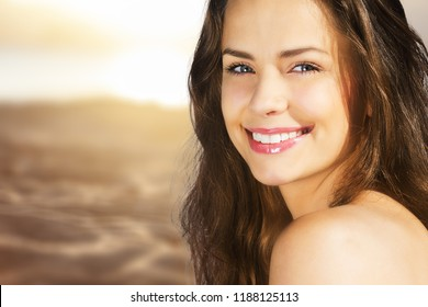 Outdoor summer portrait of pretty young smiling