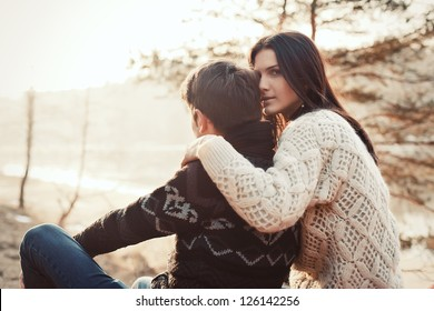 Outdoor summer portrait of young sensual couple. Boy hugs girl on the street in spring