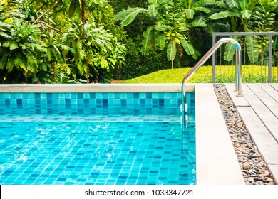 Outdoor swimming pool around hotel and resort - Holiday Vacation concept