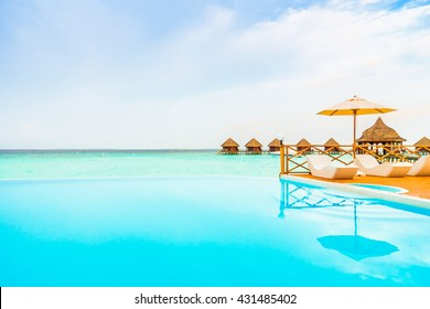 Outdoor swimming pool in Beautiful tropical Maldives island resort with beach and sea for nature holiday vacation background concept - Boost up color Processing