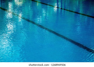 Outdoor swimming pool with clear blue water