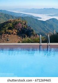 Outdoor swimming pool on top of mountain with mist