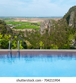 Outdoor swimming pool with view point on top of mountain