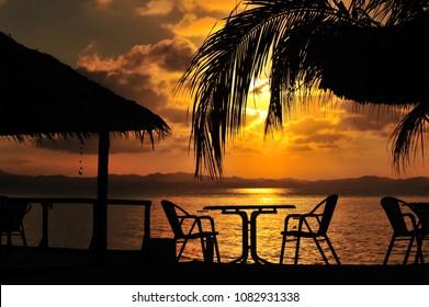 Outdoor table of a beach restaurant during sunset located at kapas island Terengganu