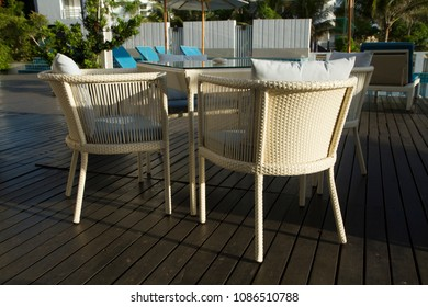 Outdoor table set with umbrella in the terrace