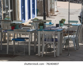 outdoor tables of a restaurant during the summer season