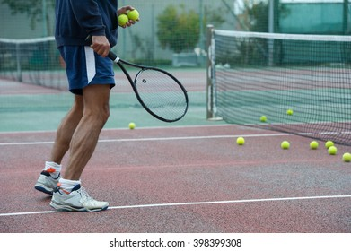 outdoor tennis coach ready for a dribble