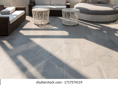 Outdoor terrace area with grey floor tile with sitting area