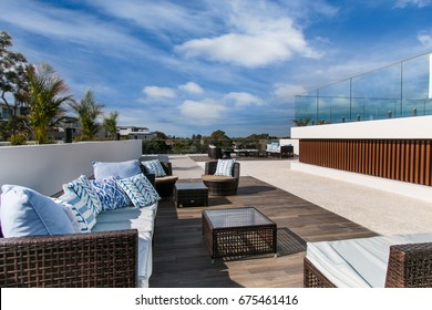 Outdoor terrace on the roof with garden furniture