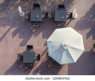 outdoor terrace with umbrella and chairs. aerial view