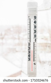outdoor thermometer shows cool and cold temperature