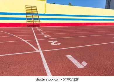 Outdoor track and field stadium runway sprint to the finish