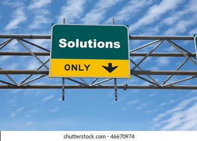 Outdoor traffic sign the word solutions on it