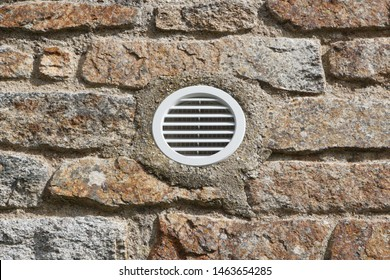 Outdoor ventilation grid in the wall of an house