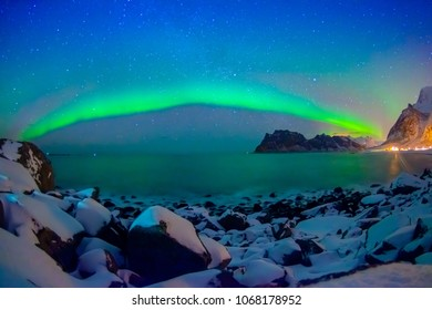 Outdoor view of beautiful multicoloured vibrant Aurora Borealis or Aurora Polaris, also know as Northern Lights in the night sky over Lofoten Islands