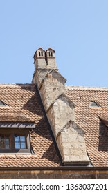 Outdoor View of Colorful Classic Castle chimneys and Windows.