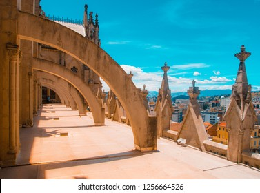 Outdoor view of colums of Basilica del Voto Nacional and downtown in the horizont located in Quito, Ecuador