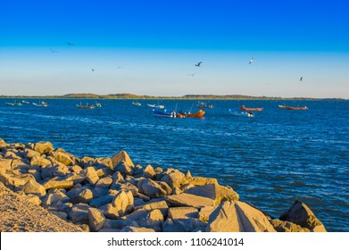 Outdoor view of fishing boats in the sea, during a gorgeous suny day in a blue sky and blue water in Corinto beach