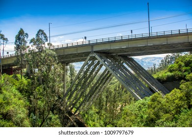 Outdoor view of metallic huge structure bridge, to visit the municipal dump in a beautiful day in the city of Quito, Ecuador