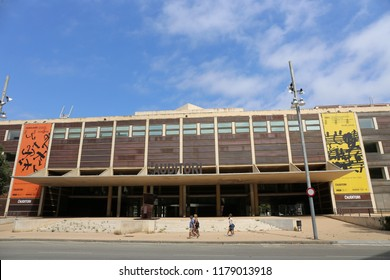 Outdoor view of the modern facade of Barcelona auditorium, called l'auditori in spanish, located in the center of the city, catalonia, spain. August, 27, 2018. Steps, rectangular shapes and pillars.