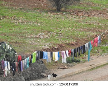outdoor view multicolored clothes on clothesline on laundry day