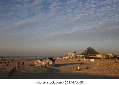 Outdoor view of the sand beach of le touquet paris plage city, north department, hauts de france region, France. December, 31, 2019. Sand and buildings at the foreground. Blue sky in background.
