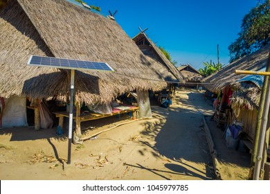 Outdoor view of solar pannel close to traditional houses of Long Neck trib, Kayan Lahwi, northern Thailand