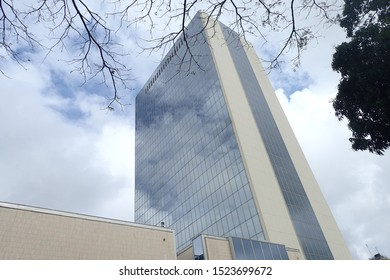 Outdoor view of the tall building called CCIA, located in Plateau district, Abidjan city, Ivory Coast. Tower used by the african developement bank, September, 28, 2019. Pattern of reflective glasses.