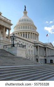 Outdoor view of US Capitol in Washington DC with beautiful blue sky in background