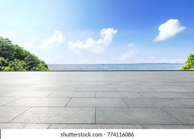 Outdoor viewing platform and lake landscape under the blue sky