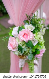 Outdoor Wedding Bouquet of Pink Roses and Drapes in a garden setting in Thailand South East Asia