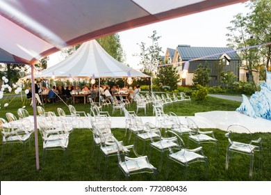 Outdoor wedding ceremony in the forest and wedding tents.
