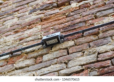 Outdoor white Electrical Outlet on brick wall