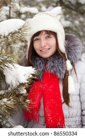 Outdoor winter portrait of girl in wintry clothes