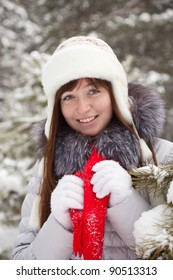 Outdoor winter portrait of woman in wintry clothes