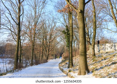 Outdoor winter scenery snowy landscape of Volkspark Rehberge, Goethe Park, Rathenaubrunnen and waterside of Plötzensee lake in Wedding district, in Berlin, Germany.
