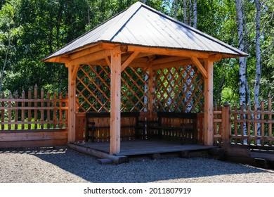 Outdoor wooden gazebo in the woods