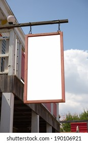 outdoor wooden shop sign with blue sky. useful for your advertisement.