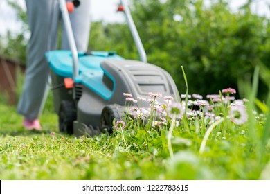 outdoor worker mowing the lawn