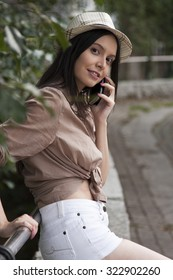 outdoor young girl talking on the phone