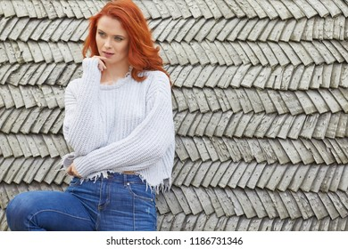 Outdoors autumn portrait of beautiful woman with red hair